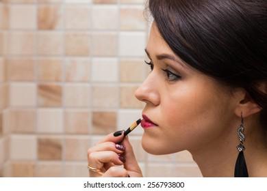 Makeup. Eyebrow Makeup. Eyes. Lips make-up. Beautiful woman doing makeup.