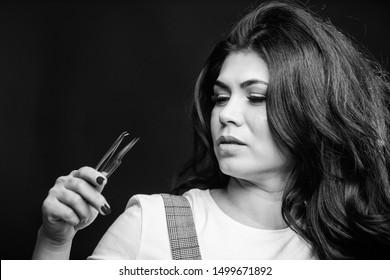 Makeup false lashes volume. Lash applicator. Professional eyelash extension tweezer. Makeup artist. Cosmetic tweezer. Beauty shop concept. Girl makeup face hold tweezer for eyelash extension.