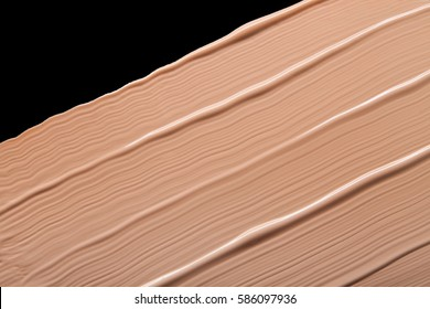 Makeup foundation blur cream black background