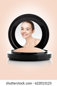 Makeup foundation powder case with beautiful model reflection on pink  background