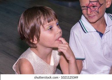 Make-up girl and boy watch the theater play