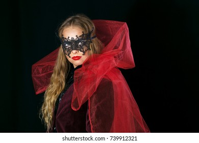 make-up girl witch on halloween costume in black mask