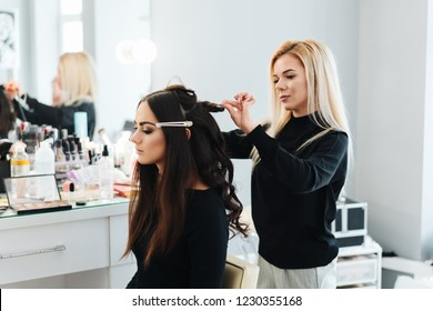 Makeup and hairstyle for a beautiful model, beauty saloon