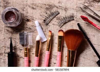 Makeup kit on wooden background
