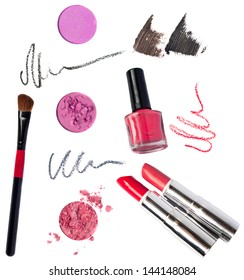 Makeup kit pink eyeshadow, red, terracotta lipsticks, special professional brush for applying, red, black, gray pencil strokes, brown, black mascara sctokes, nail polish bottle. Isolated on white