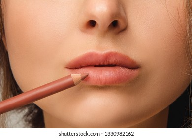 Makeup Lips. Closeup Of Beautiful Young Woman Applies Color Contour Lip Pen, Lip Liner. Girl Contouring Sexy Full Lips With Lip Pencil, Beauty Product. Cosmetics Concept. High Resolution Image - Image