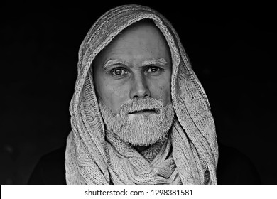 make-up man with a beard / concept oriental portrait in traditional dress, gray-haired white beard in an Arab man