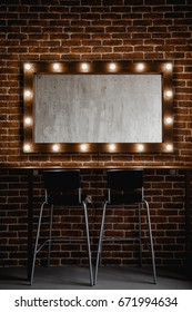 A makeup mirror with light bulbs on a brick wall background