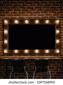 A makeup mirror with light bulbs  and wooden frame on a brown brick wall background with black space for text inside