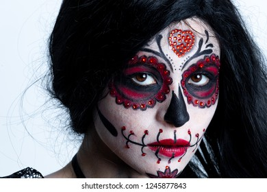 Make-up model with theme Mexican Day of the Dead in a study session in madrid, spain