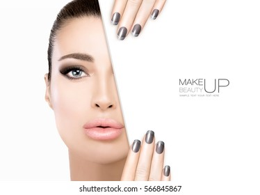 Makeup and Nail Art Concept. Gorgeous beauty model with smoky eye makeup, foundation on a unblemished skin and trendy metallic nail polish. Half face with a white card template. High fashion portrait