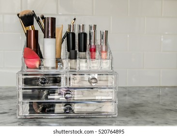 Makeup organizer with numerous items.