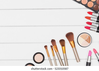 Makeup palette colorful with set of makeup brush equipment for makeup artist, top view photography.