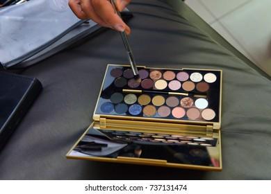 Makeup, palette colors. Hand
