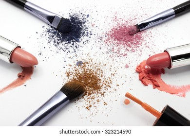 Makeup powder and lipstick of different colors and brush