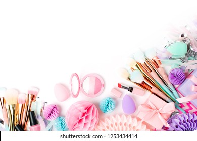 Makeup products and accessory with festive decorations. Flat lay. Beauty concept