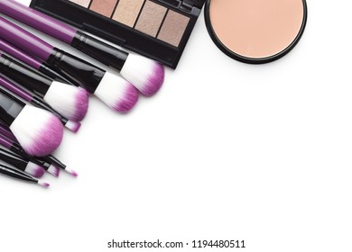 The makeup products. Brush and eyeshadow powder isolated on white background.