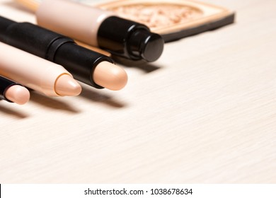 Make-up products to hide skin imperfections. Different concealers. Side view, copy space