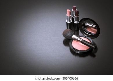 Makeup products on dark background with copy space for your text. Cosmetics and Make-up concept. Studio shot. Horizontal picture