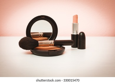 Makeup products on pink background with copy space for your text. Cosmetics and Make-up concept. Studio shot. Horizontal picture
