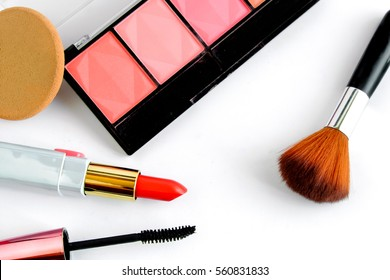 Makeup products on white background.