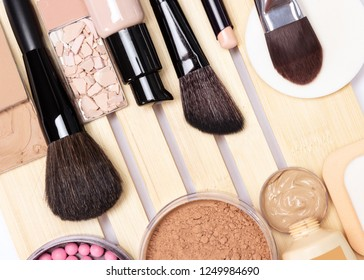 Make-up products for perfect complexion: concealer, primer, foundation, powder, blush with makeup brushes
