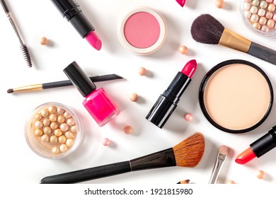 Make-up products, shot from the top on a white background. Various cosmetics