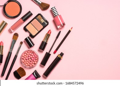 Makeup professional cosmetics on pink background. Flat lay image with copy space.