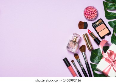 Makeup professional cosmetics on purple background. Top view with copy space.