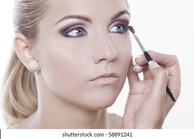 make-up session on a beautiful girl