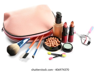 Makeup set with beautician, eyelash curler, brushes and cosmetics on white background