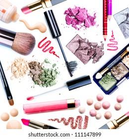 Makeup. Make-up Set. Collage. Mascara, lipgloss, lipstick, rouge, eyeshadows, eyeliner, foundation isolated on a white background