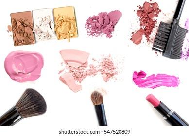 Makeup. Make-up Set.Collage.Mascara,lipgloss,lipstick,rouge,eyeshadows,eyeliner,foundation isolated on a white background