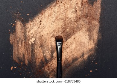 Make-up smeared on black Surface and beauty Brush