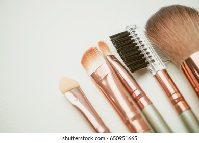 makeup tools, accessories and blank space for beauty background