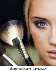 makeup woman with make up brush. half face