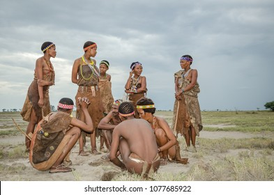 Makgadikgadi Salt Pans, Botswana - April 1st 2015: a group of traditional Basarwa gather together at the fire.