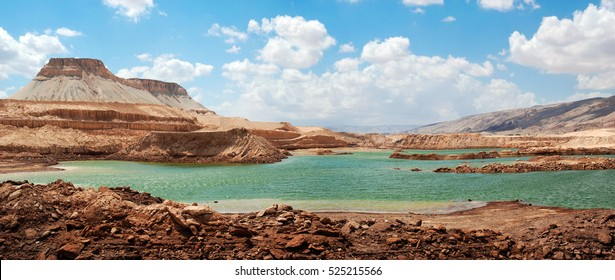 Makhteshim Mitzpe Ramon. Small Machtesh (Crater) Israel. Negev Desert. Spring in the desert. Israel Color of the Earth, where the soil has a lot of different colors. Green Lake. Lake with green water.