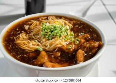 Maki Mi or pork tenderloin egg noodle in thick brown broth