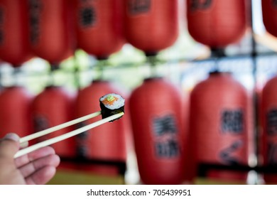 Maki roll with salmon and wasabi, popular Japanese cuisine