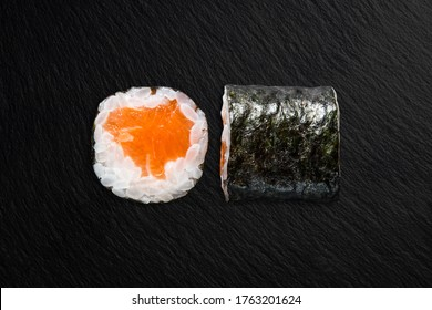Maki with salmon on a black background