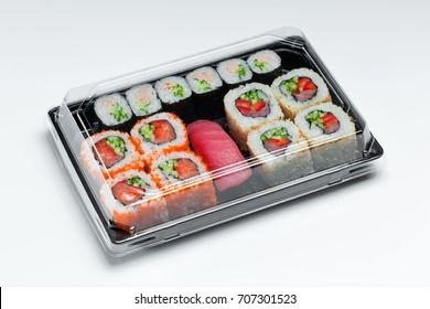Maki sushi set in a plastic box  close up isolated on a white background. Sushi for take away , sushi delivery in plastic container