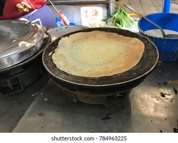The making of Appam or Palappam using hot pan. Appam is one of the most popular and traditional Kerala breakfast bread.