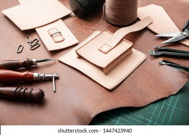 Making bag from vegetable tanned leather in workshop.