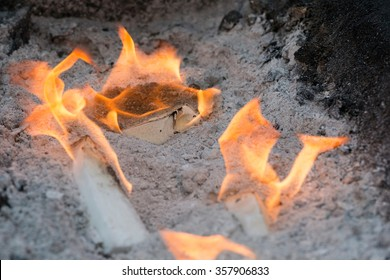 making a barbecue fire with fire lighters to cook meat, chops, chicken and sausage