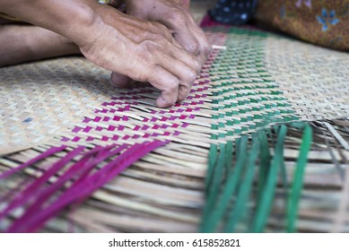 Making a basketwork from grass-like plant called sedge in the south of Thailand