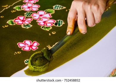 Making Batik, painting traditional batik