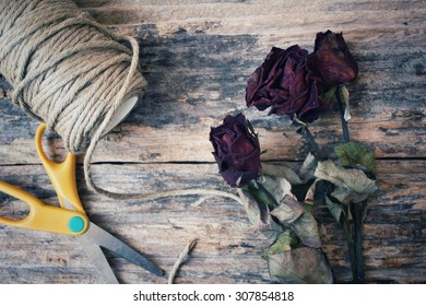 Making bouquet with dried red roses flower