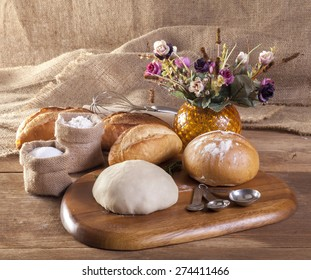 Making bread on table on wooden background