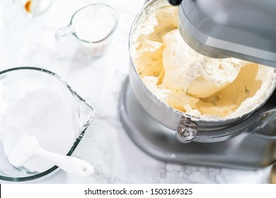 Making buttercream frosting for decorating a vanilla cake.